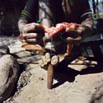 Mpiriyon, cutting camel meat, Ngurunit, Kenya, 2006