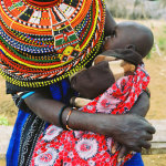 Nankaya, feeding her baby, Ngurunit, Kenya, 2006