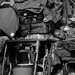 Seko, sleeps amongst gifts and supplies en route to Malawi, Wineloop Flats, Johannesburg Central, 2006
